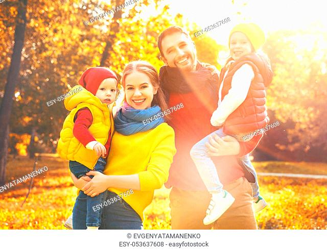 happy family mother, father and children on an autumn walk in park