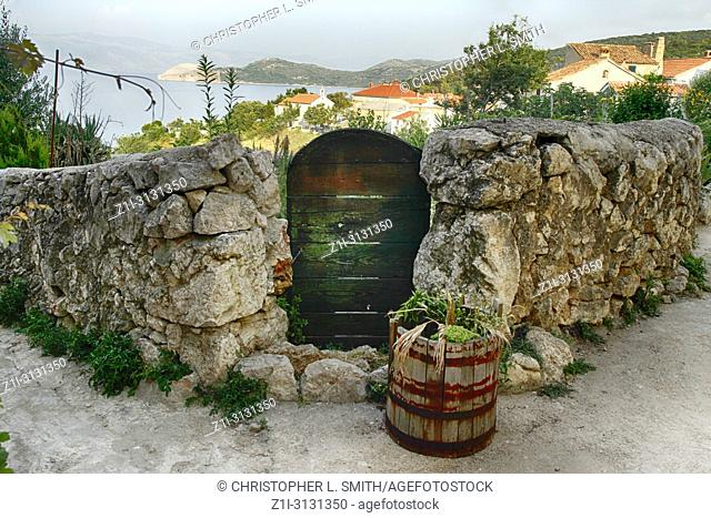 Gate overlooking a scene of the medieval village of Vrbnik on the Croatian island of Krk