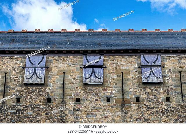 Windows, with wooden shutters, in a castle wall