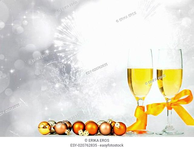 Glasses with champagne against sparkling holiday lights