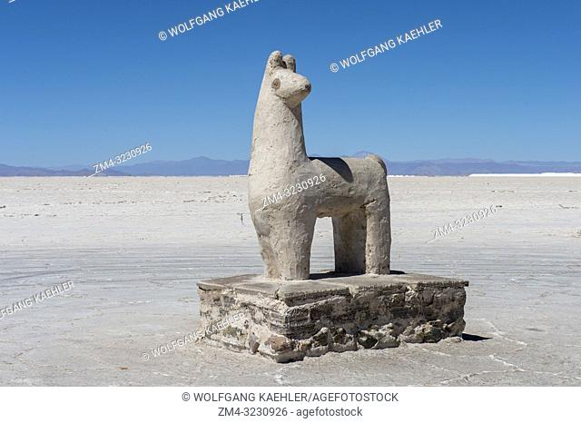 A llama statue carved out of salt at Salinas Grandes a salt pan in the Andes Mountains - is situated on an altitude of 3