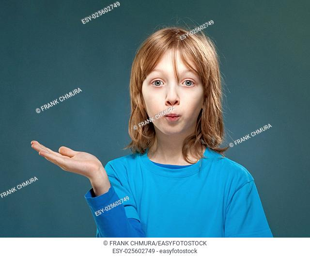 Boy in Blue Top Looking with his Palm Outstretched