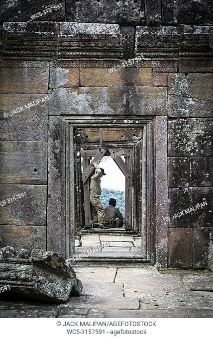 police man security guards at preah vihear landmark temple ruins in north cambodia