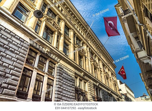 Turkish flags hanging and waving on a stone ancient building. ISTANBUL, TURKEY, APRIL 22, 2017