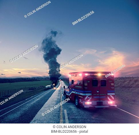 Ambulance driving to car crash