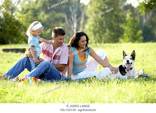 A young family seeking relaxation in a park.  - Dresden, GERMANY, 05/09/2005