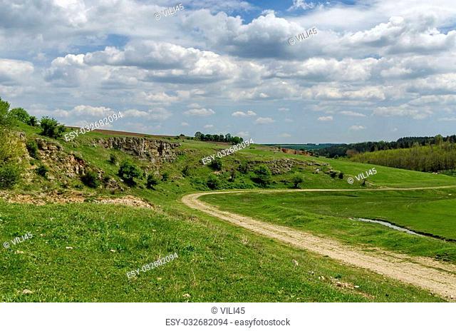 General view toward sedimentary rock in the field, Ludogorie, Bulgaria