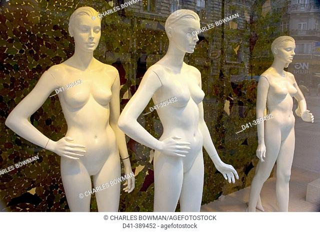 Naked mannequins in shop window