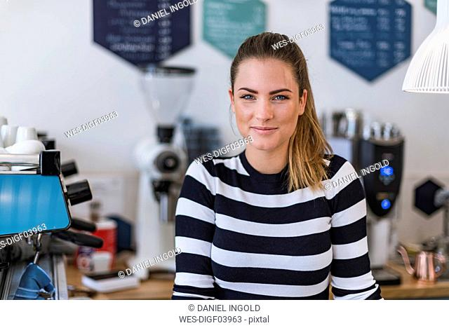 Portrait of smiling young woman in a cafe