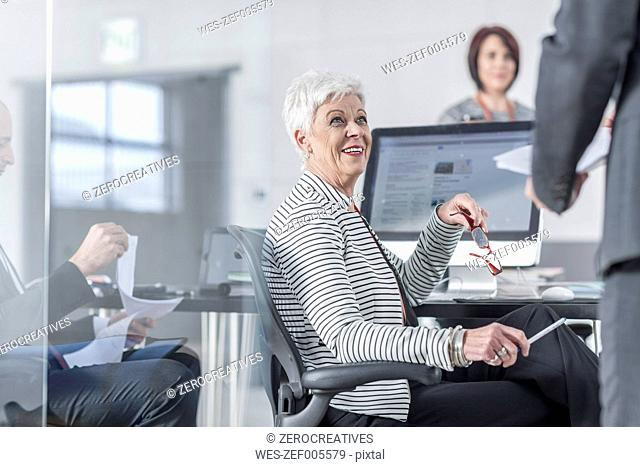 Colleagues in office working together