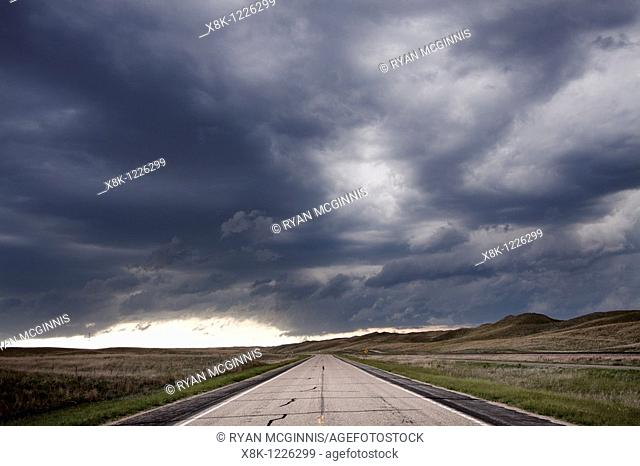Storm clouds gather over the road in the Sandhills of Nebraska, May 29, 2010