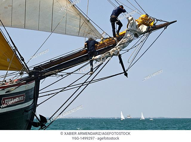 Working in the bowspirit  French Tall ship Etoile de France, Bay of Morbihan, Brittany, France