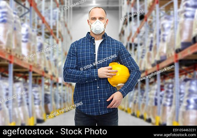 male worker wearing respirator mask at warehouse