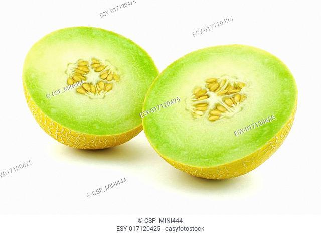 Two halves of yellow melon cantaloupe