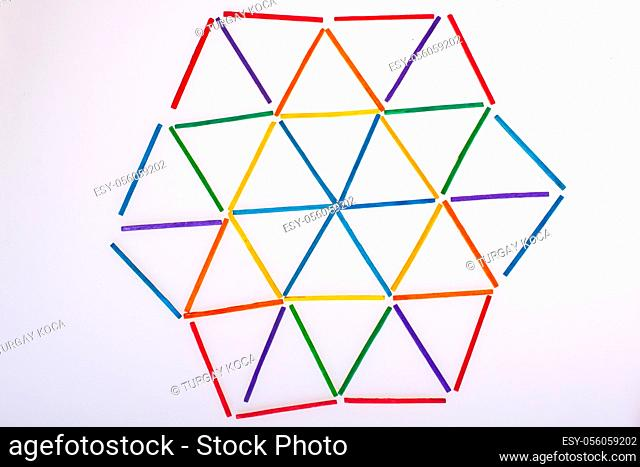 Geometric figures triangles formed with colorful sticks