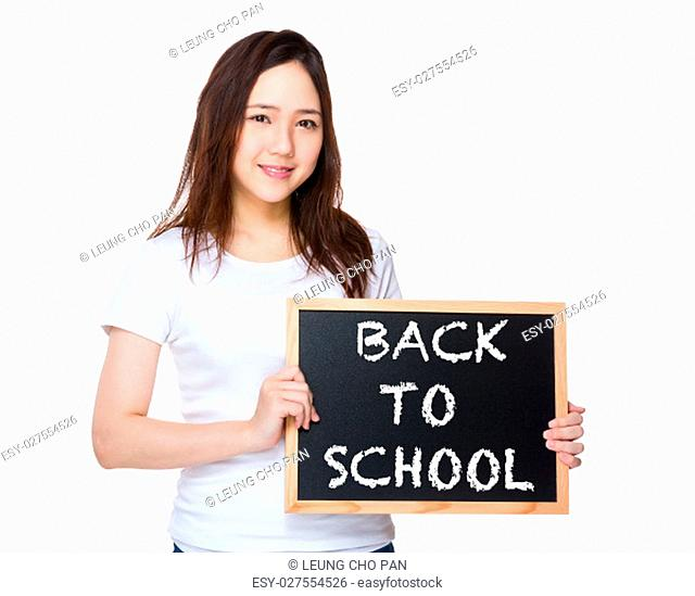Young woman hold with blackboard showing phrase of back to school