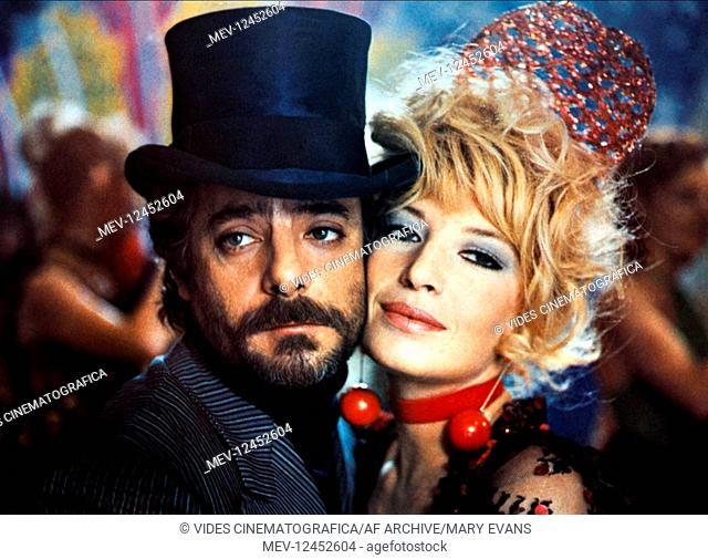 Giancarlo Giannini & Monica Vitti Characters: Gino Benacio, Tina Candela Film: A Mezzanotte Va La Ronda Del Piacere (1975) Director: Marcello Fondato 19...