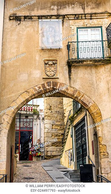 Old 12th Century Arch Arco de Almediina Medieval City Coimbra Portugal. Arch leads to Upper Town and University in Coimbra
