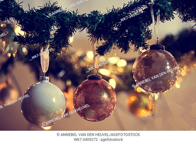 Decorated Christmas tree on blurred, sparkling and fairy background, christmas balls decoration, winter holiday