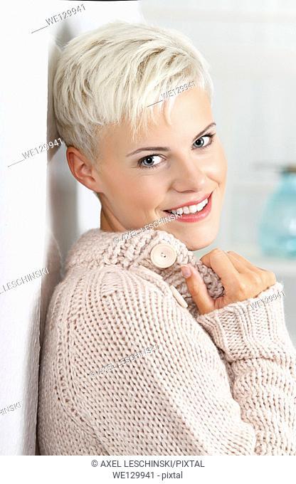 Woman in cardigan smiling