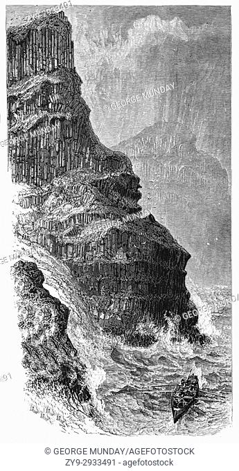 1870: A whaler in rough seas below Pleaskin Head, part of the Giant's Causeway, an area of about 40,000 interlocking basalt columns