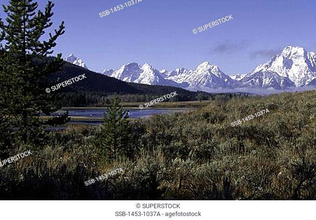 Panoramic view of snow covered mountains, Teton Range, Grand Teton National Park, Wyoming, USA