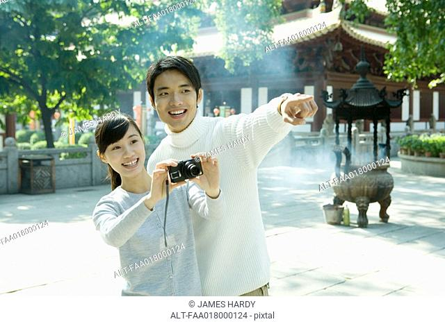 Young couple taking photo
