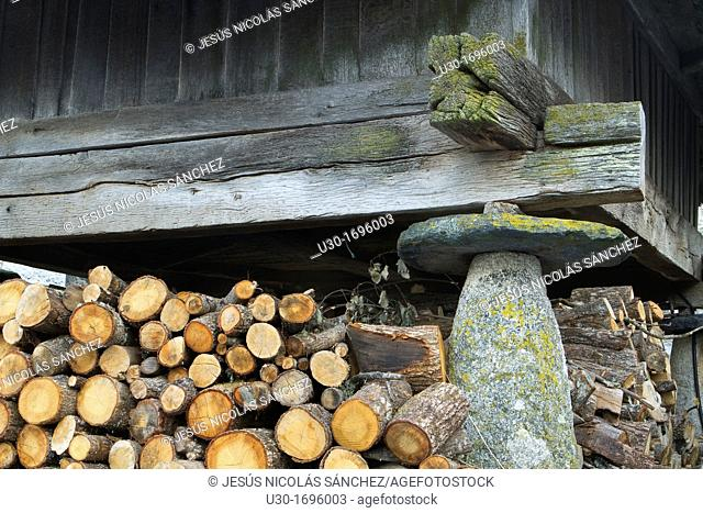 Pile of logs protected under a traditional 'horreo' in Piornedo village, Sierra de Ancares  Lugo Province, Galicia  Spain