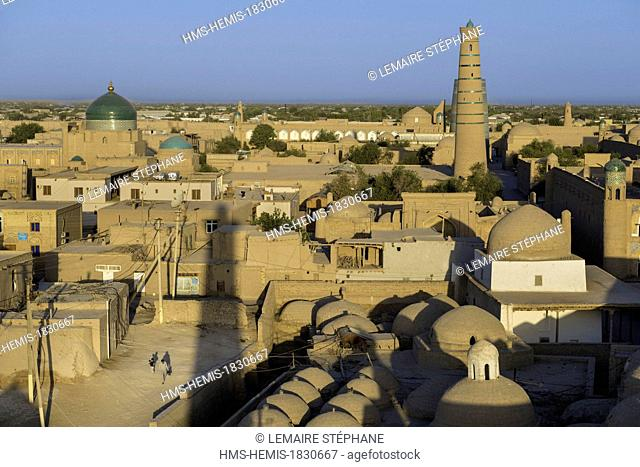 Uzbekistan, Silk Road, Khorezm province, Khiva, Itchan Kala protected city, listed as world heritage by UNESCO, city sight and Islam Hoja Minaret seen from the...