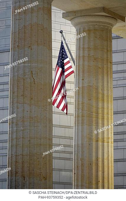 The US flag photographed between two columns of the Brandenburg Gate on the US embassy building at Pariser Platz in Berlin-Mitte, 17.05.2017
