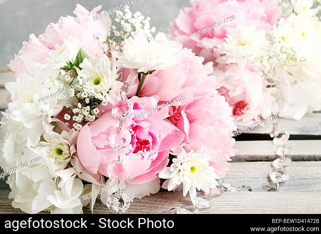 Floral arrangement with pink peonies, white chrysanthemums and gypsophila paniculata twigs. Party decor