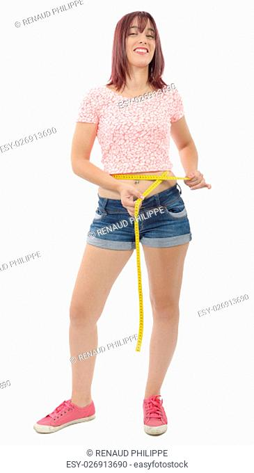 young woman measuring her waist on white background