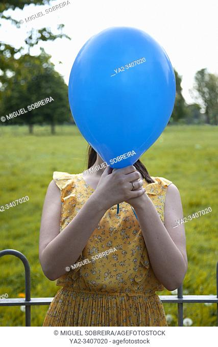 Woman With Balloon in Front of Face