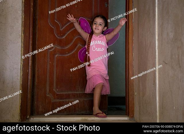 18 June 2020, Egypt, Cairo: Sahar Ahmed, 4 years old, poses for a picture while explaining how she wants to travel back to Saudi Arabia to see her father who is...