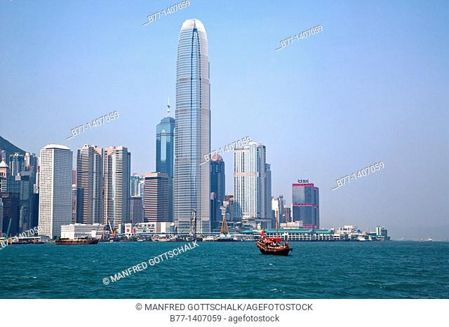 China, Hong Kong, view of the Central District skyline and the 414 metre tower of Two International Finance Centre across Victoria Harbour