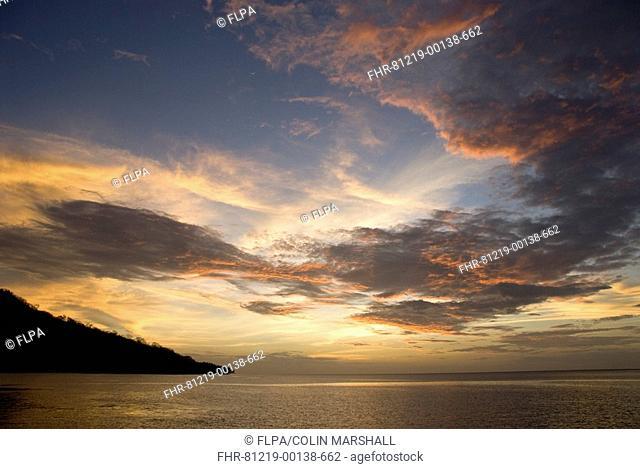 Sunset over sea, near Perai Village, West Wetar Island, Alor Archipelago, Lesser Sunda Islands, Indonesia