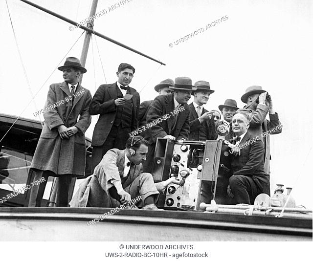 "New York, New York, 1925 Testing equipment on the yacht """"Elce"""" from which the Childs Cup Rowing Regatta on the Harlem River will be broadcast to the nation by..."