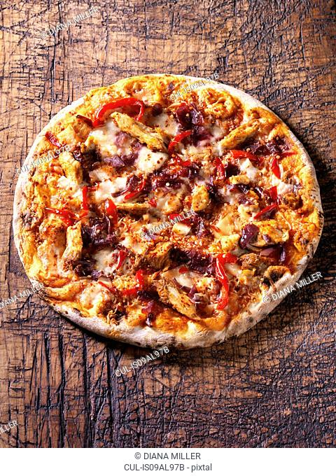 Italian spicy chicken pizza with red chillies, red onion and mozzarella