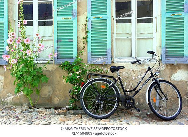 Bicycle in front of a House surrounded by flowers and Hollyhock Alcea Rosa, Saint Martin en Re, Ile de Re, Charentes Maritime department, France, Europe