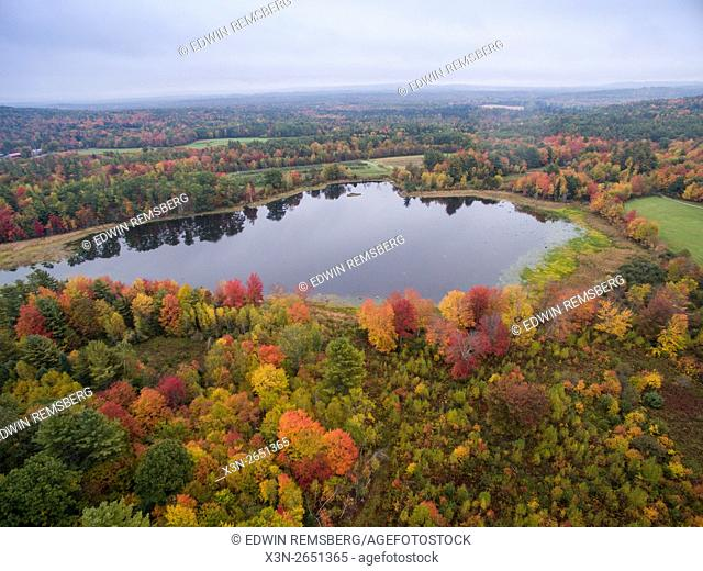 Aerial view of fall foliage and a pond in Livermore, Maine