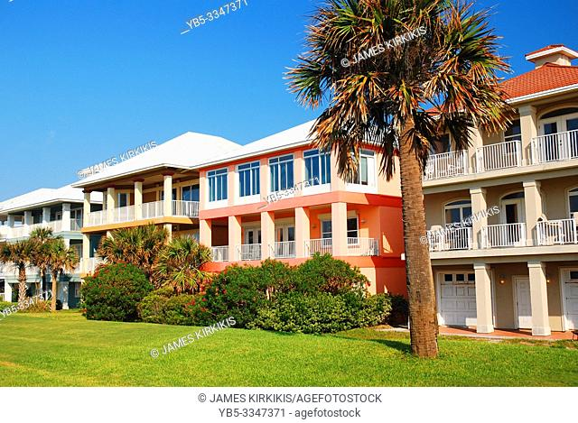 Residential buildings painted in bright pastel colors on Floridaâ. . s Gulf Coast