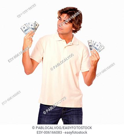 Portrait of a charismatic fashionable man holding cash money while standing on white background