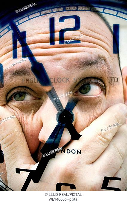 Closeup of a clock and a face of a man with a concern expression on the back ground