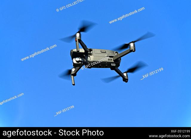 Drone in flight against the blue sky