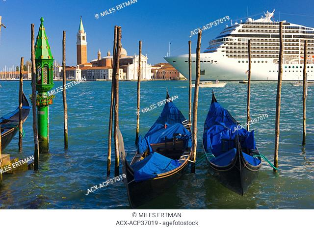 Gondolas with the church of Saint George Major and cruise ship in the background, Venice, Italy