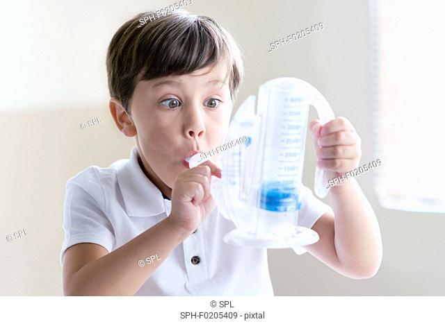Boy using breathing equipment