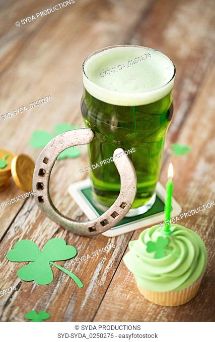 glass of beer, cupcake, horseshoe and gold coins