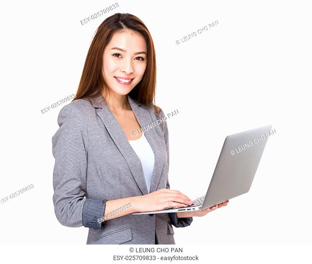 Business woman use of the laptop computer