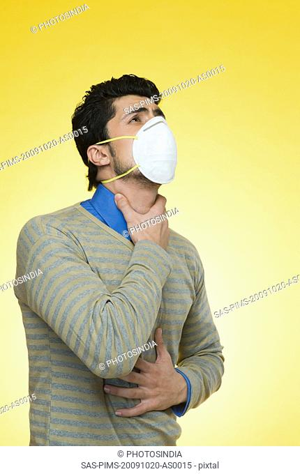 Man wearing a pollution mask