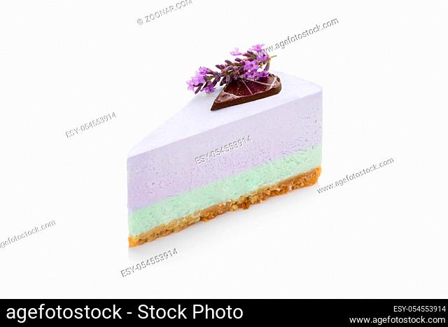 Delicious lavender cake isolated on white background with chocolate and flowers